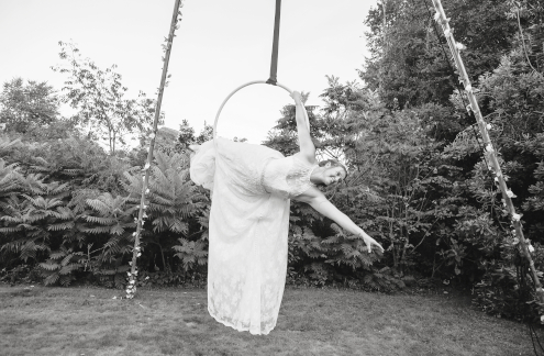Lisa Truscott doing aerial hoop in her wedding dress.