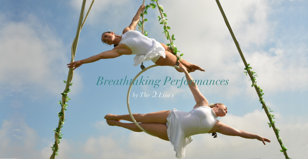 Welcome to The 2 Lisa's, aerial performances for your wedding or event entertainment.